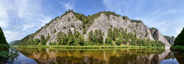 Ural Mountains with lake reflection
